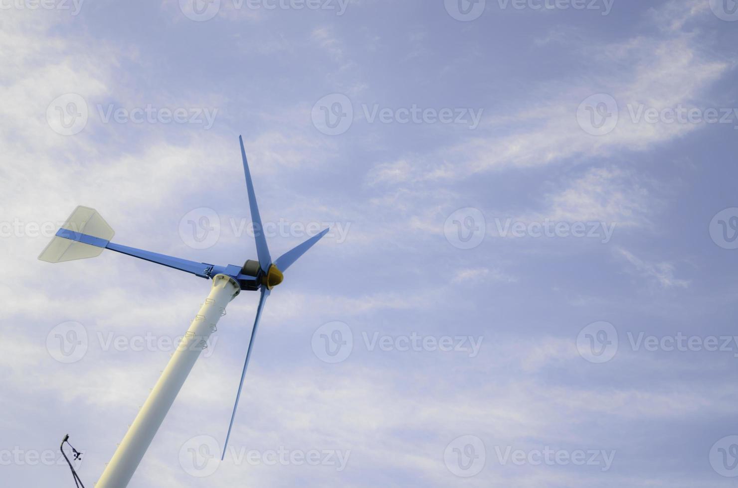 Wind Turbine with blue sky photo