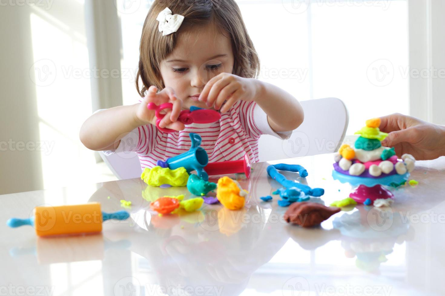 Girl playing with play dough photo