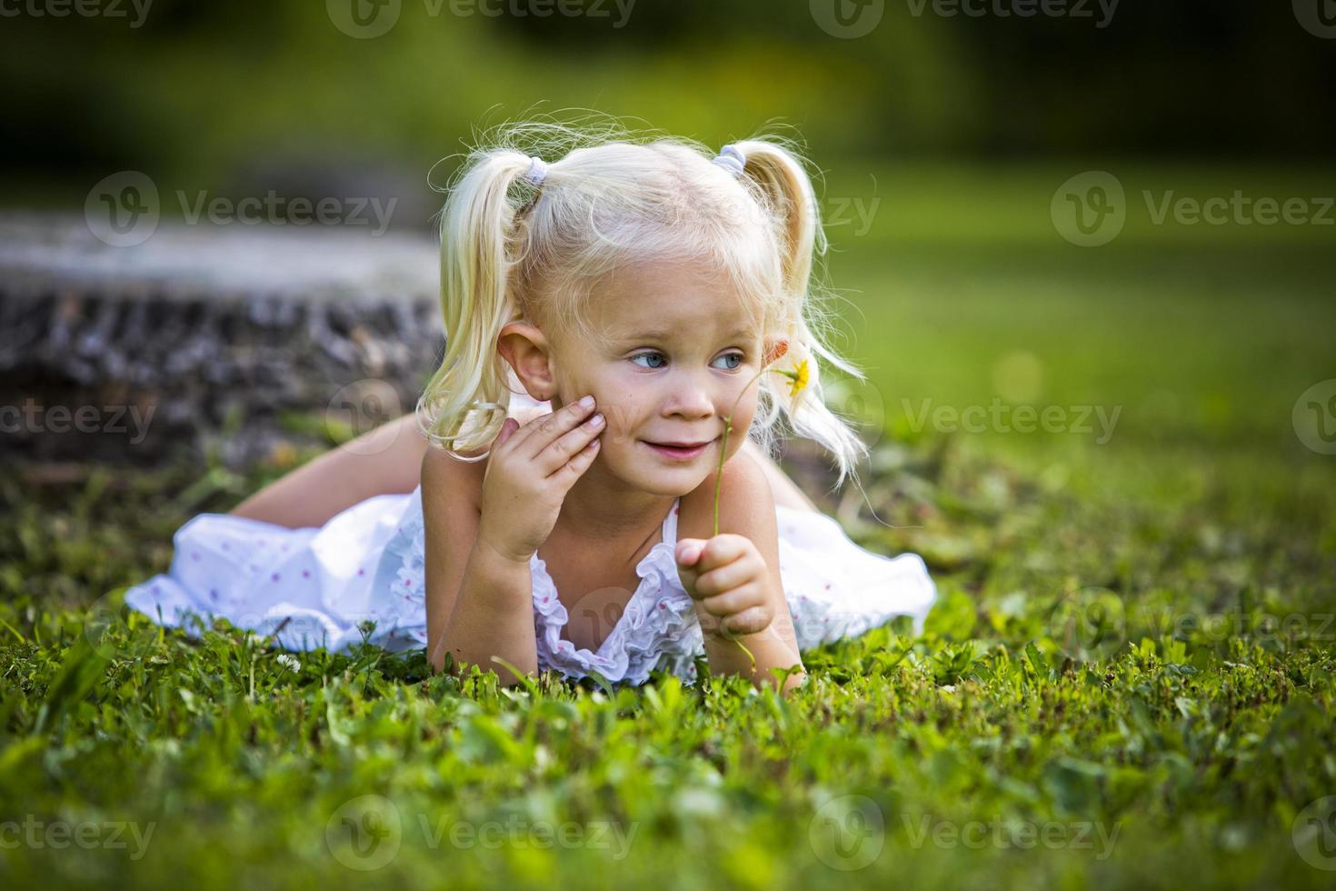 portrait of a little girl in the park photo