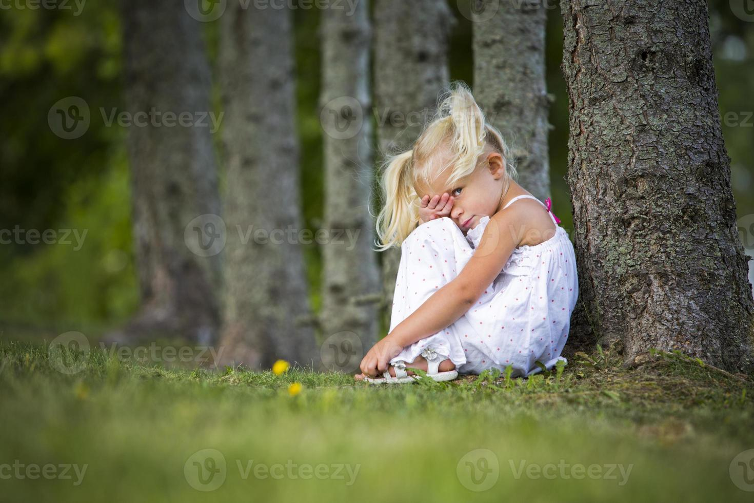 shy little girl in the park photo