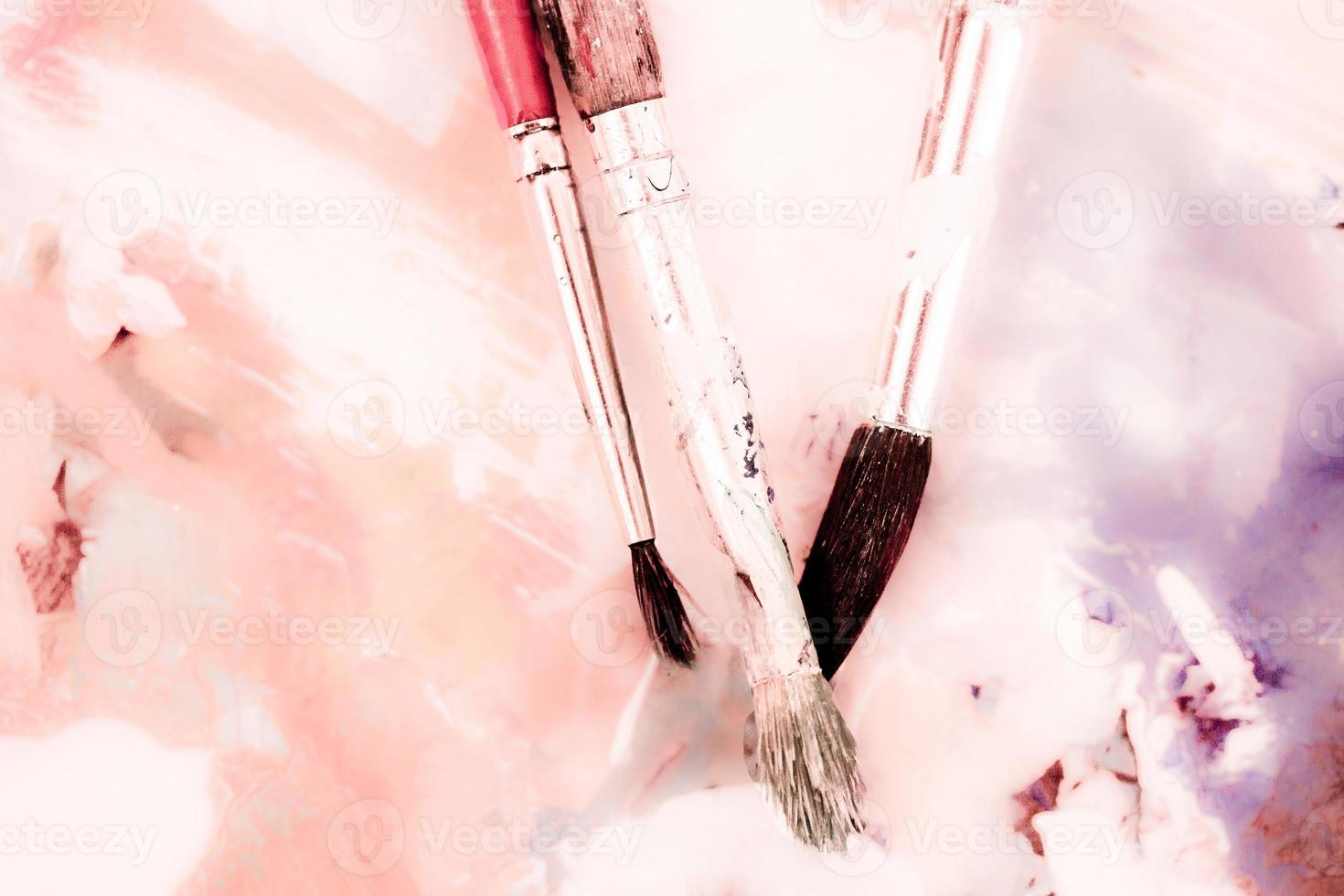 Dreamy photo of paintbrushes and watercolor drawing in pastel colors