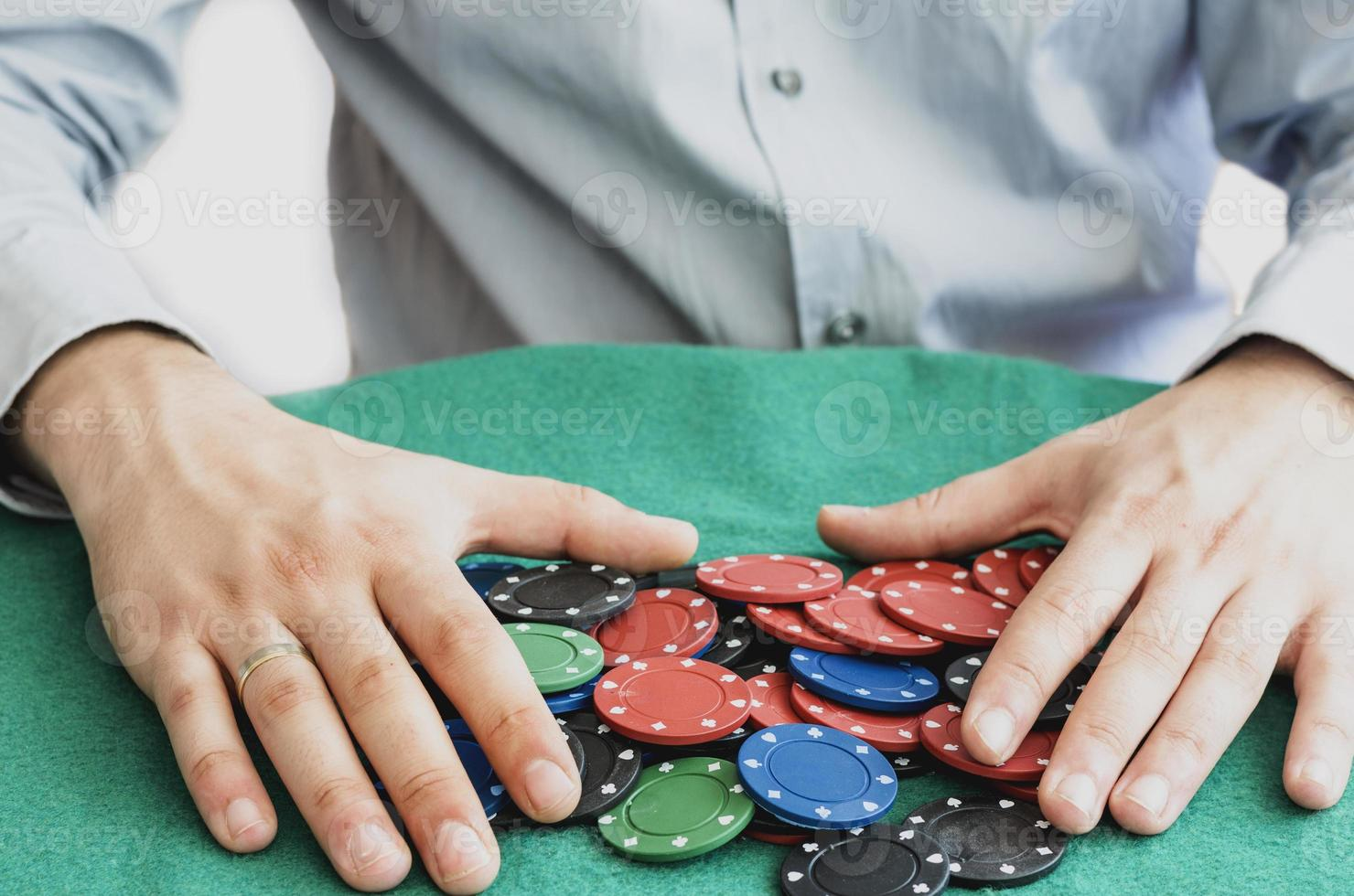casino chips in red green and black. photo