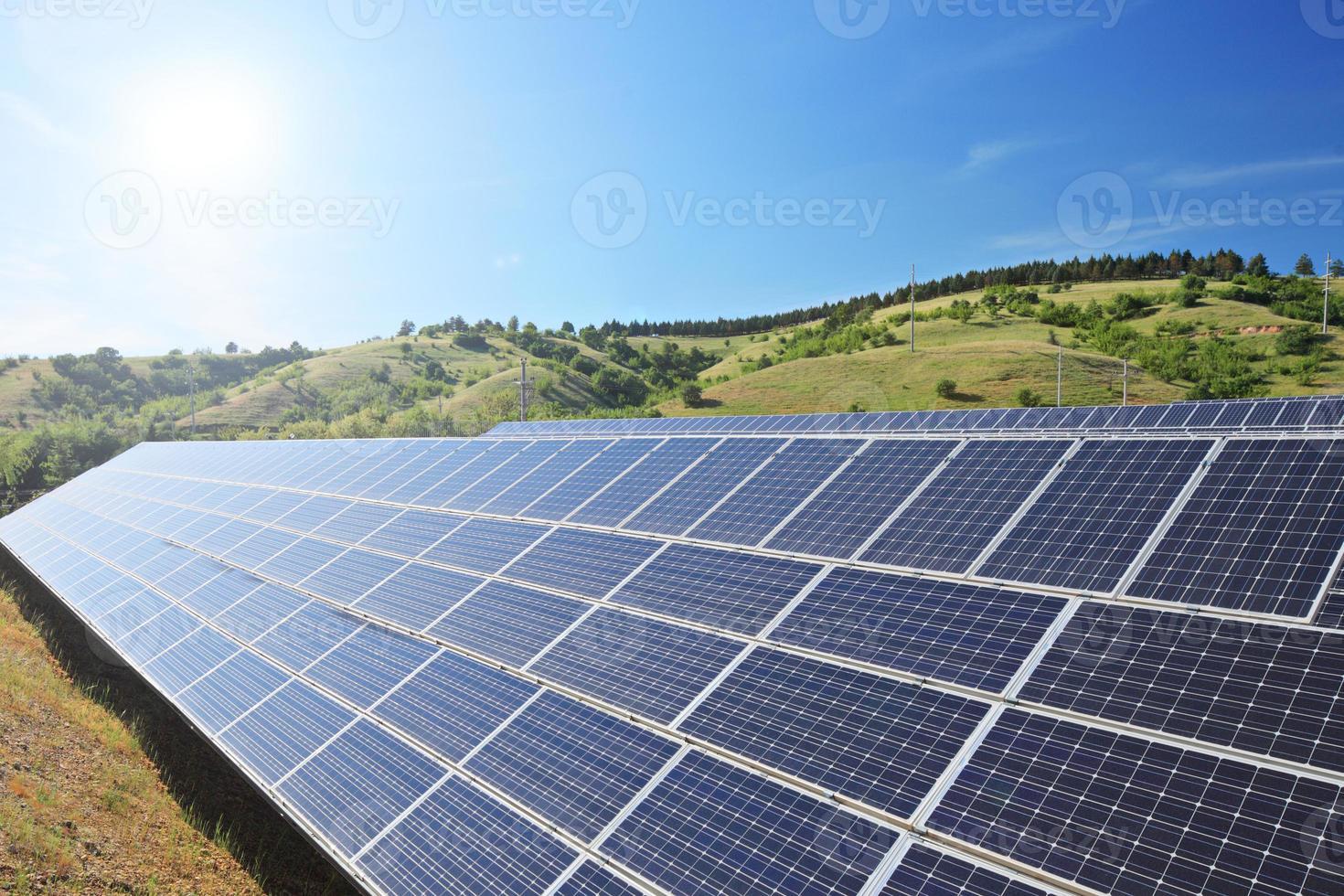 Solar photovoltaic cell panels under sunny sky photo