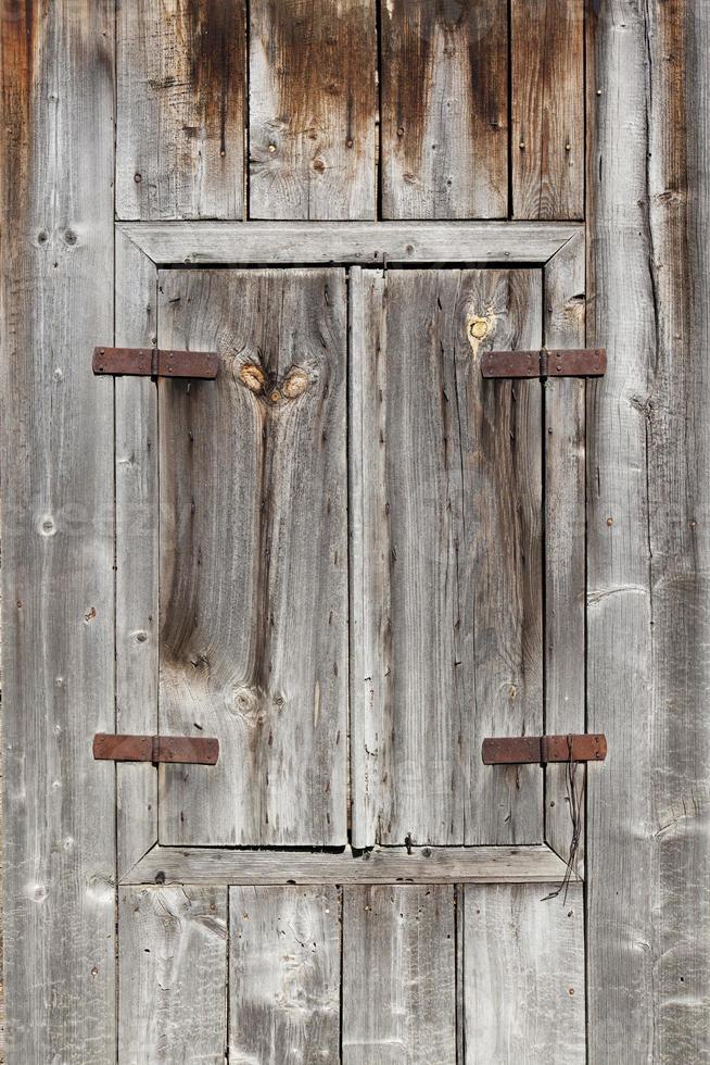 Closed wood window shutter photo