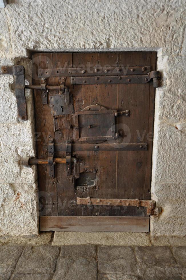 Venecia - puerta cerrada presion medieval foto