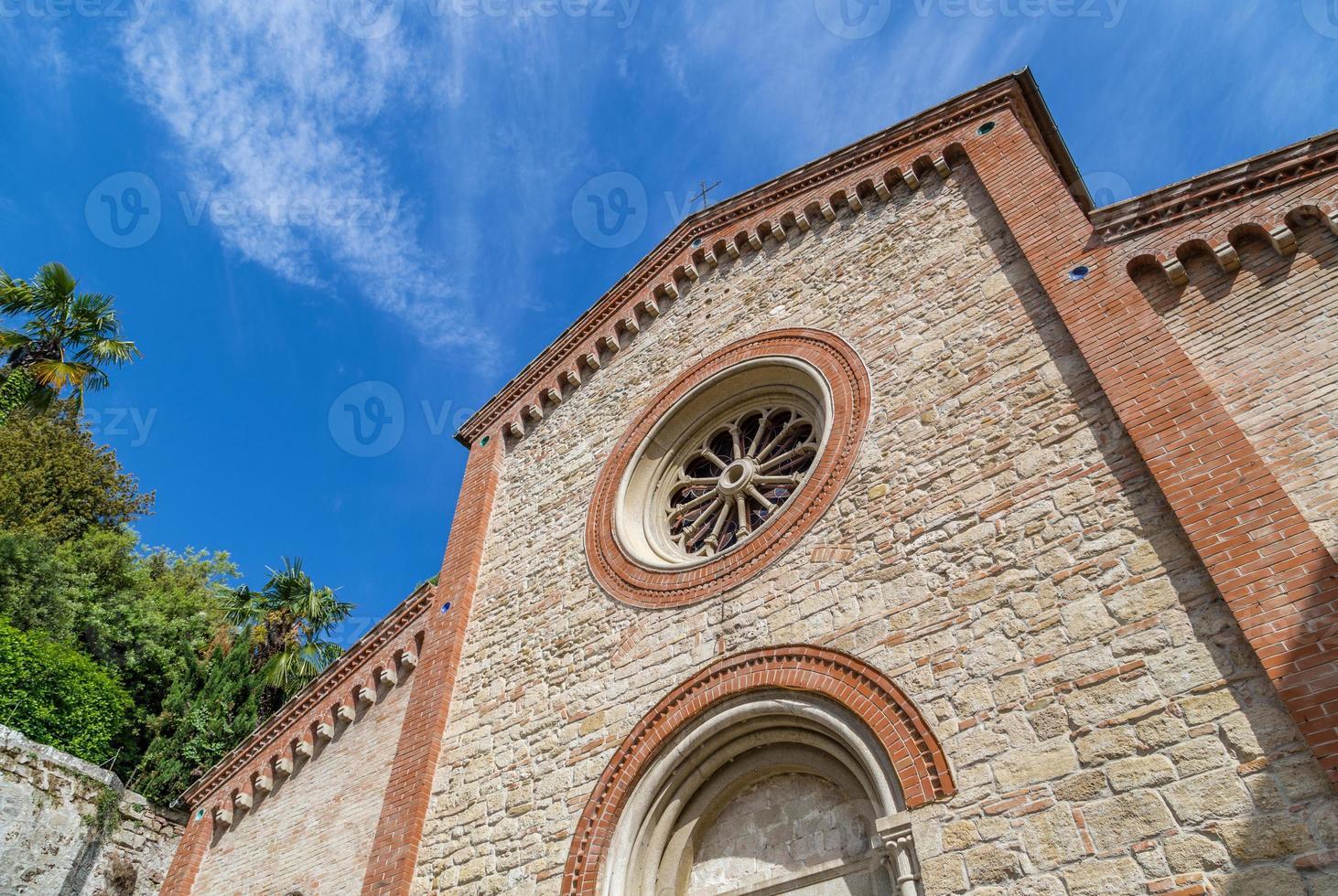 Facade of XIV Catholics parish church in Italy photo