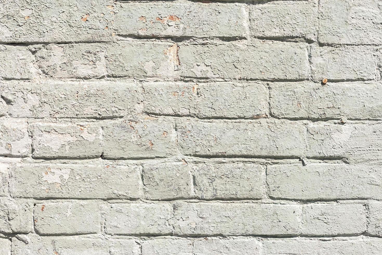 pared de ladrillo blanco. muro de hormigón blanco sucio foto