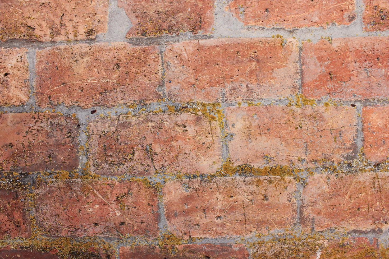viejo muro de ladrillo rojo foto