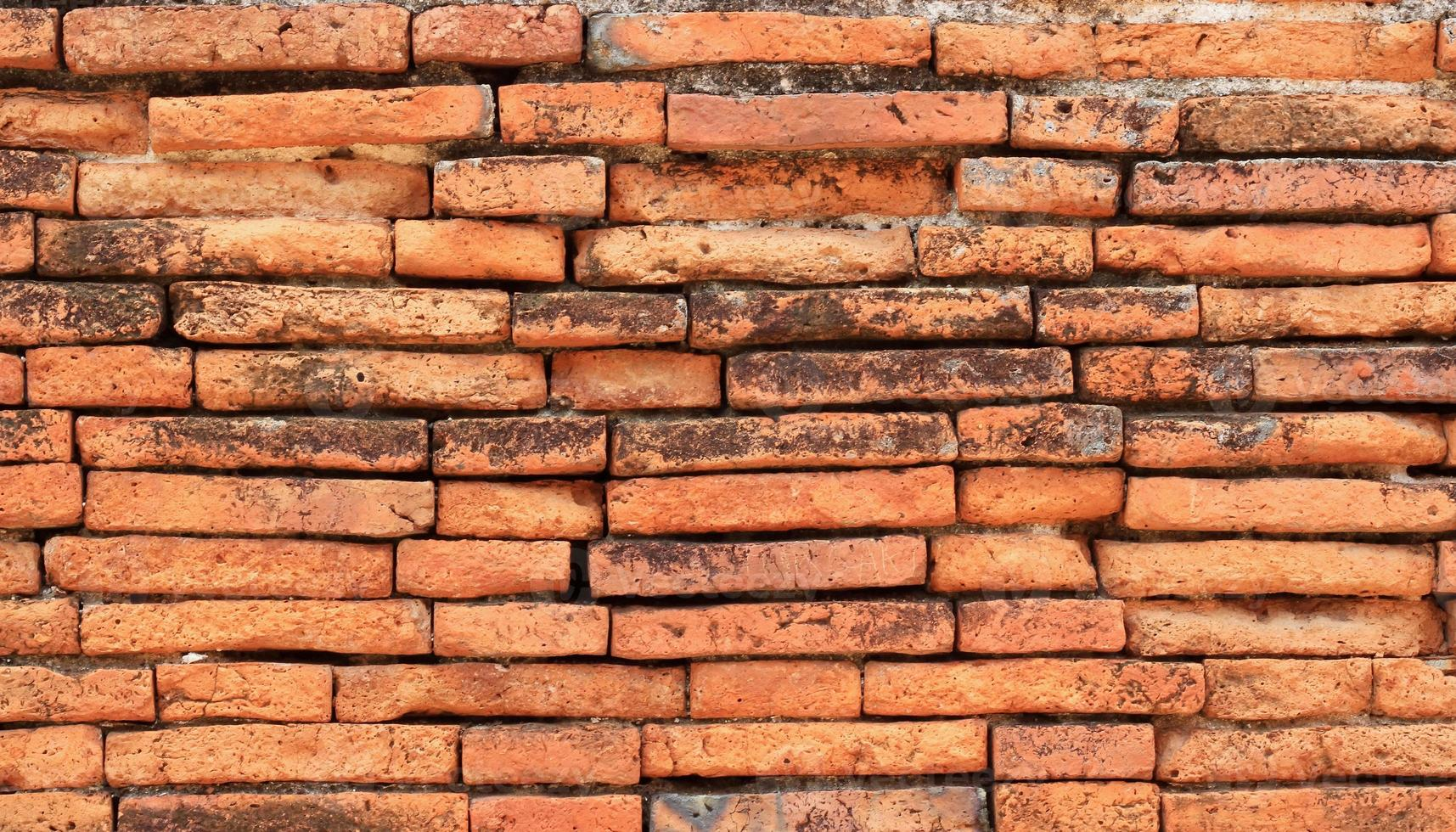 Fondo de textura de pared de ladrillo rojo antiguo foto