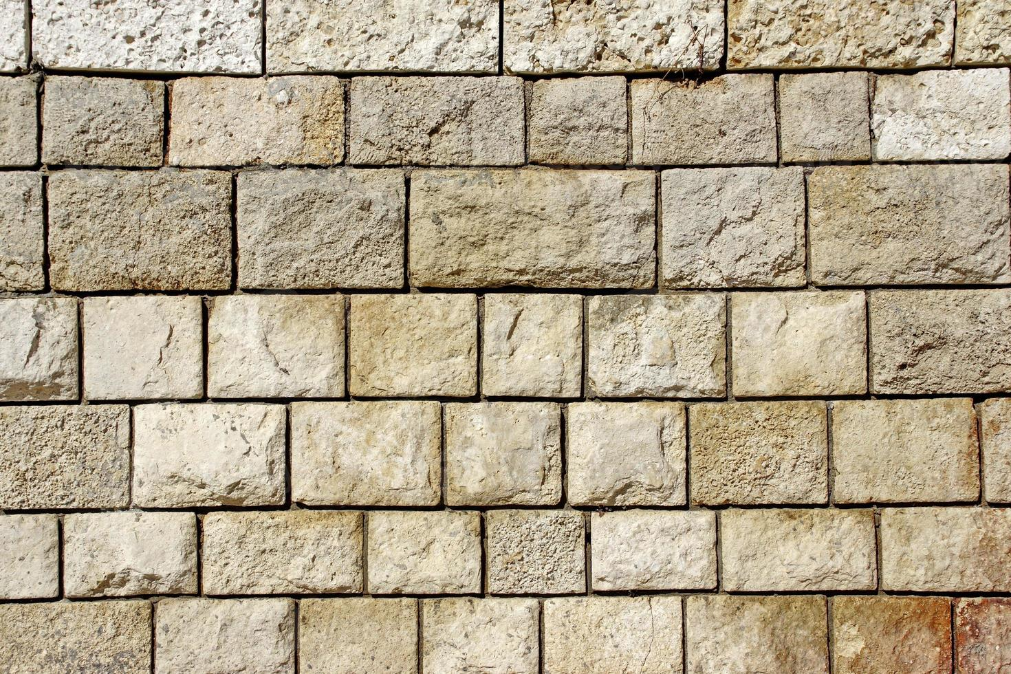 antiguo muro de piedra caliza decorativa foto