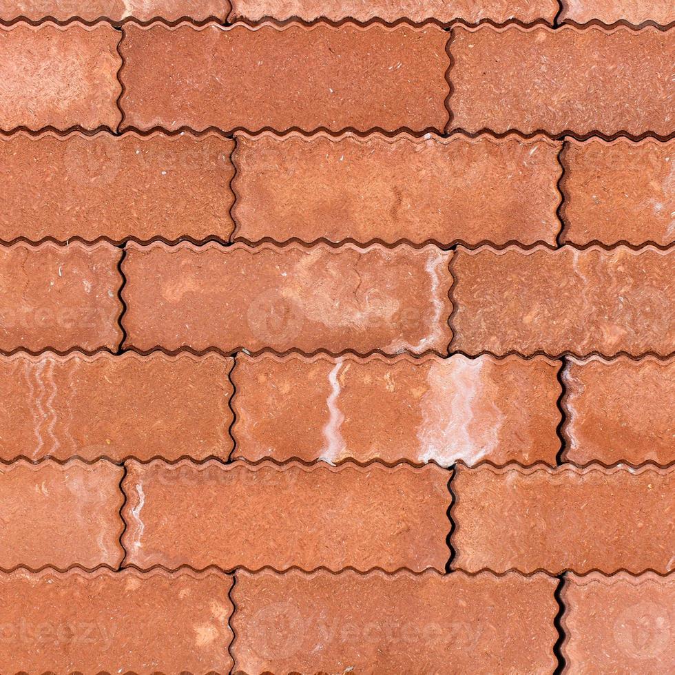 La pared de bloques naranja podría usarse para textura de fondo foto