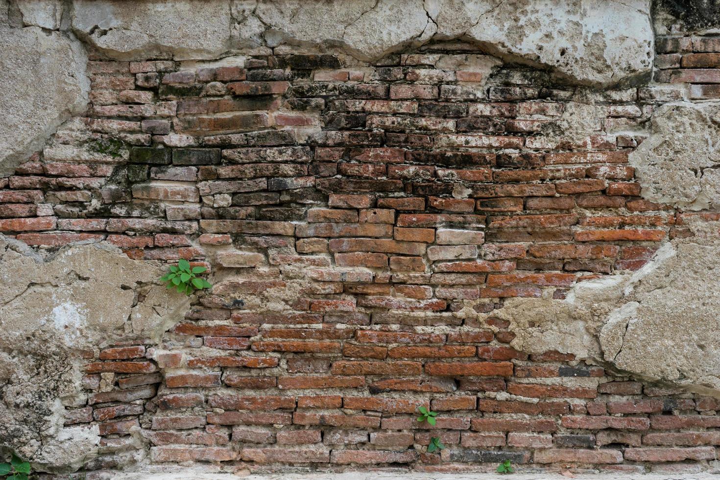 Fondo de pared de ladrillo vintage de hormigón agrietado foto