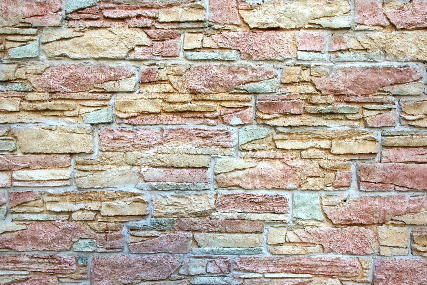 nuevo muro de piedra natural colorido decorativo foto
