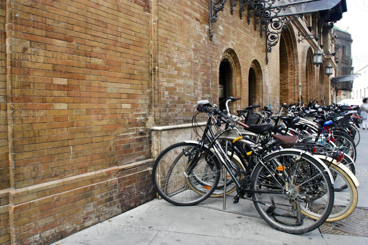 Group of bicycles in urban parking photo