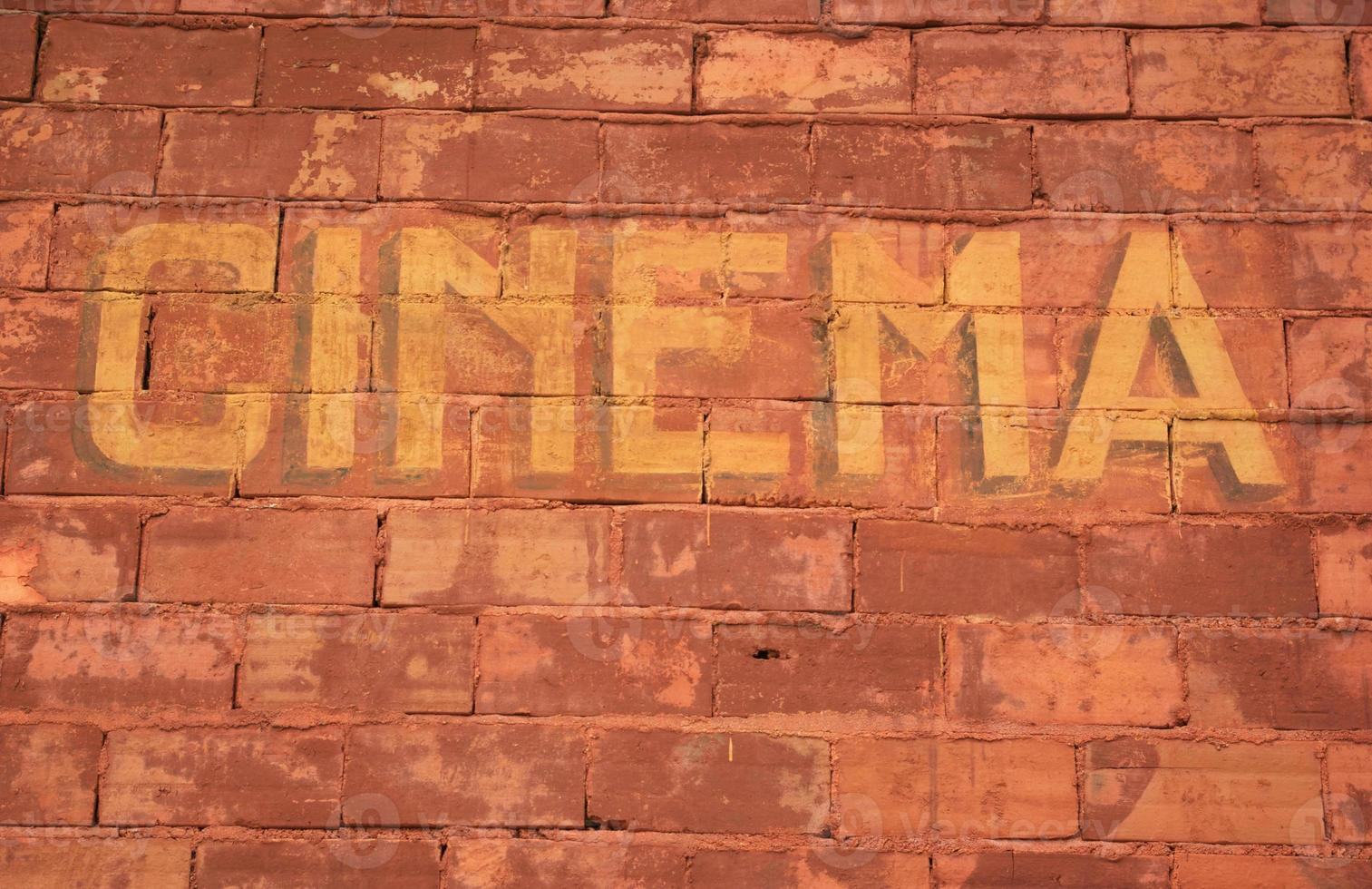 Text CINEMA painted on a brick wall photo
