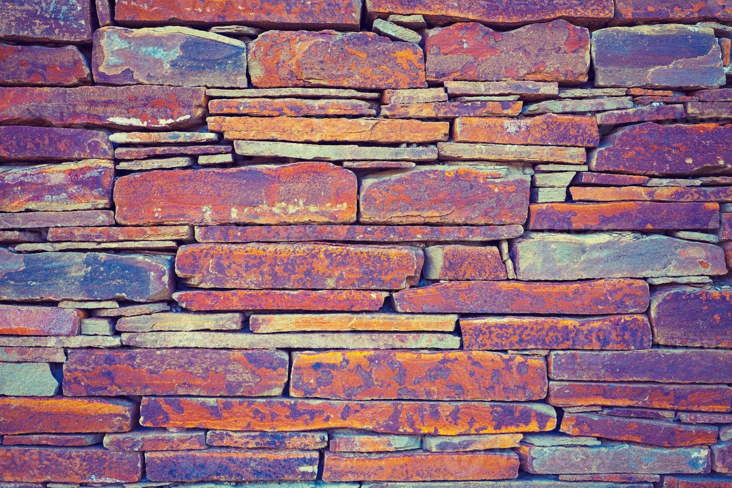 Grunge vintage wall of stone tiles photo