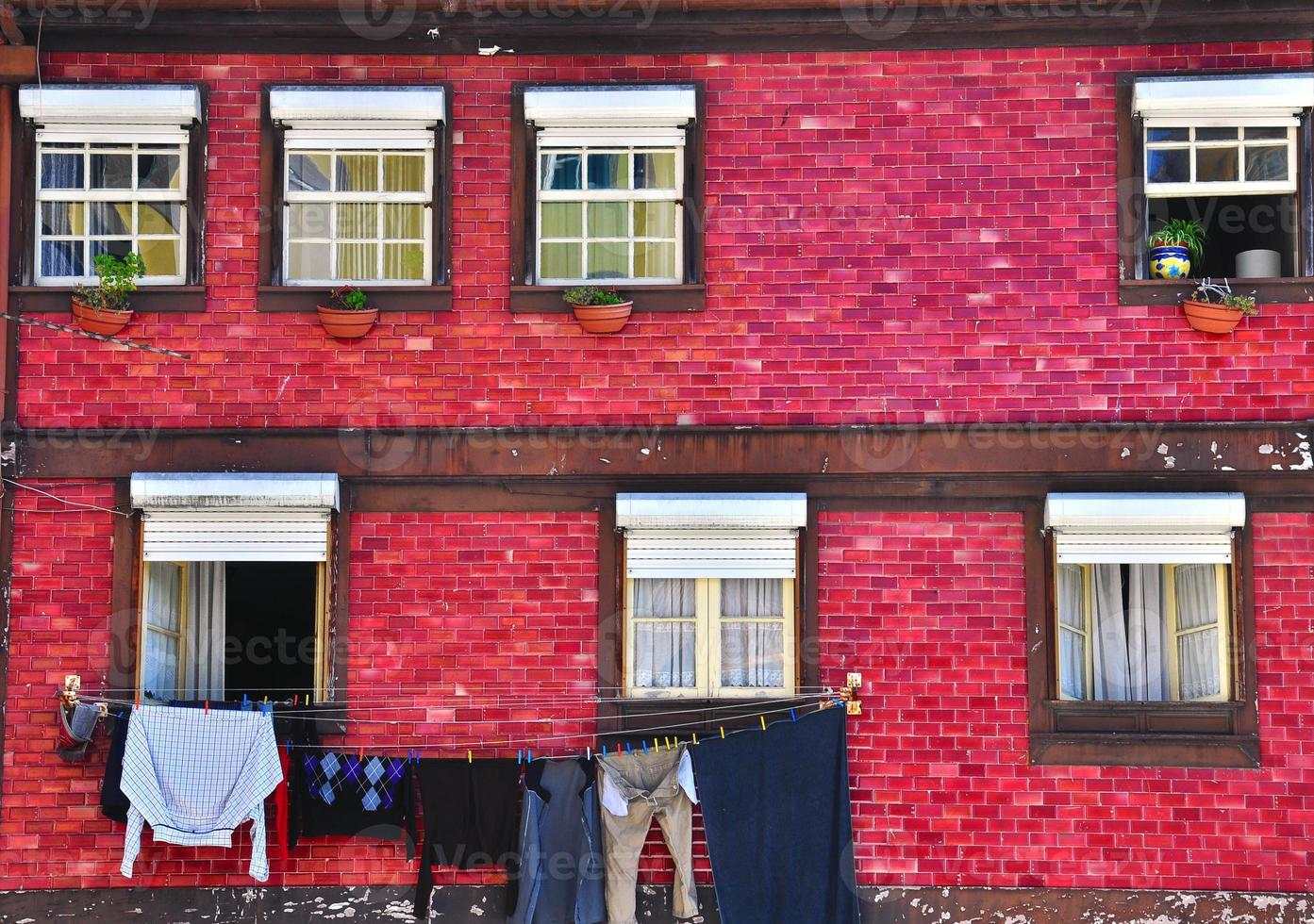 Old colorful house with tiled walls photo