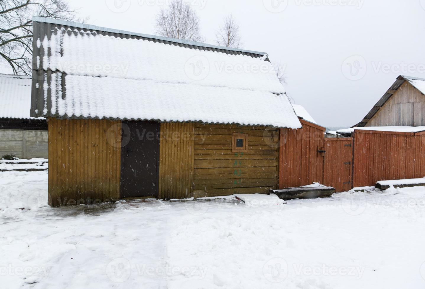 wooden constructions under snow photo