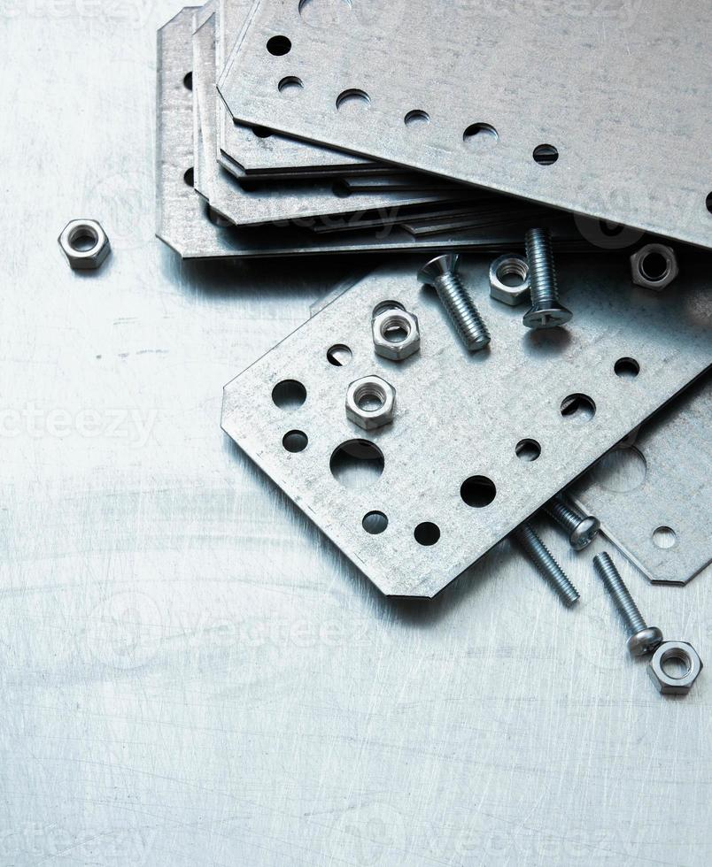 Metal preparations and fixing elements on the scratched metal background photo
