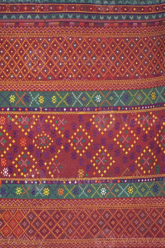Colorful thai silk handcraft organic using natural dyes close up photo