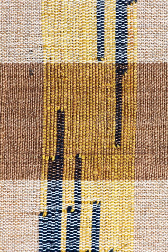 Colorful thai peruvian style rug surface close up. photo
