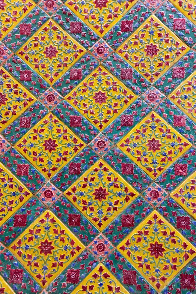 ancient ceramic tile decorated with Thai art photo