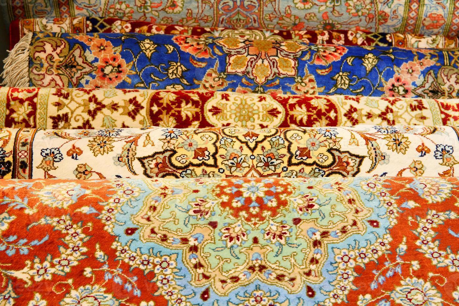 Many vibrant multicolored Persian carpets photo