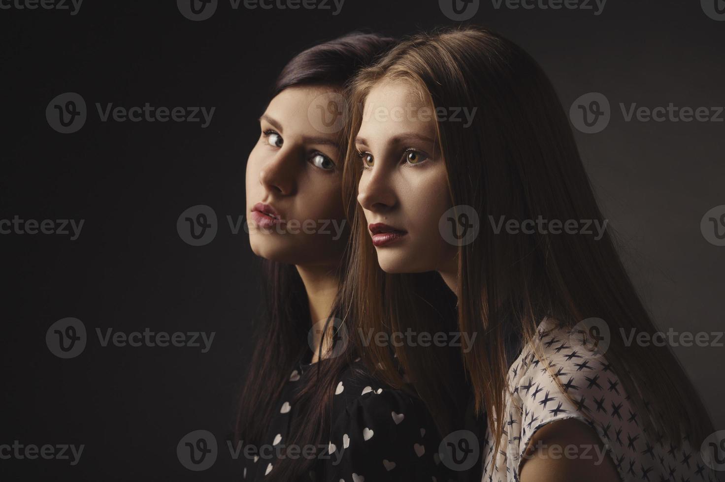 girls studio portrait on dark background photo