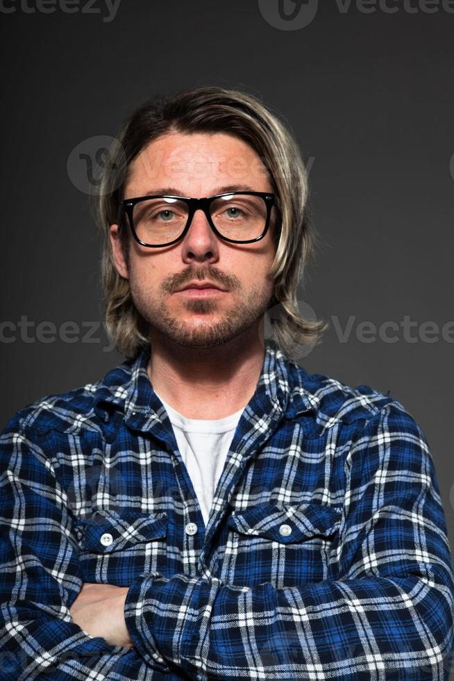 Young man with blond hair and beard wearing retro glasses. photo