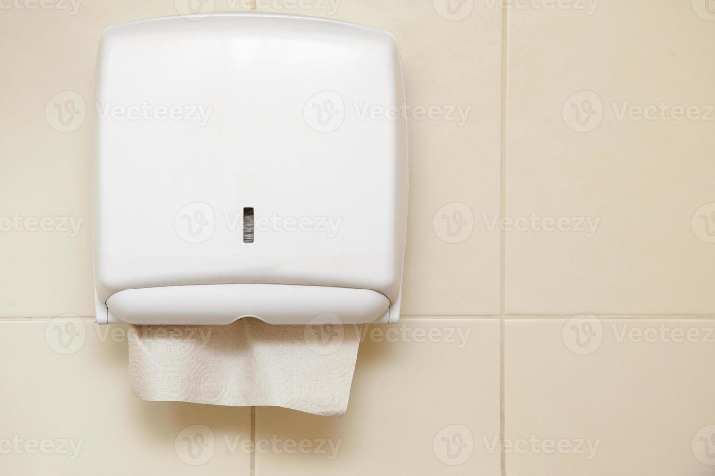 Paper towel dispenser in the bathroom photo