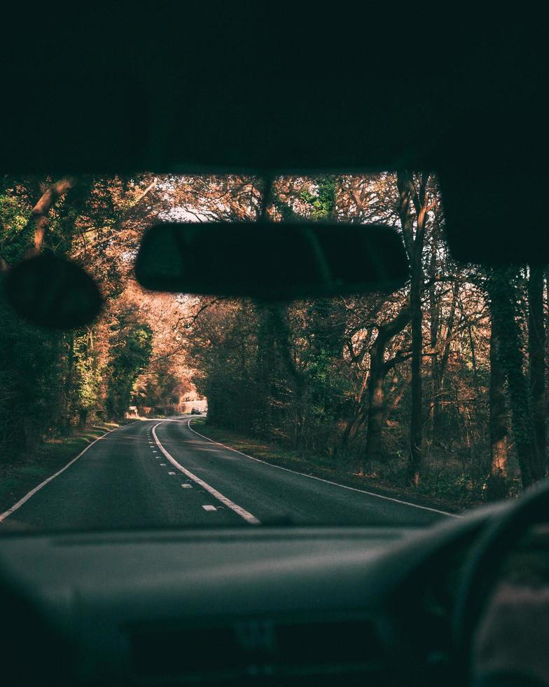 View of a road through windshield photo