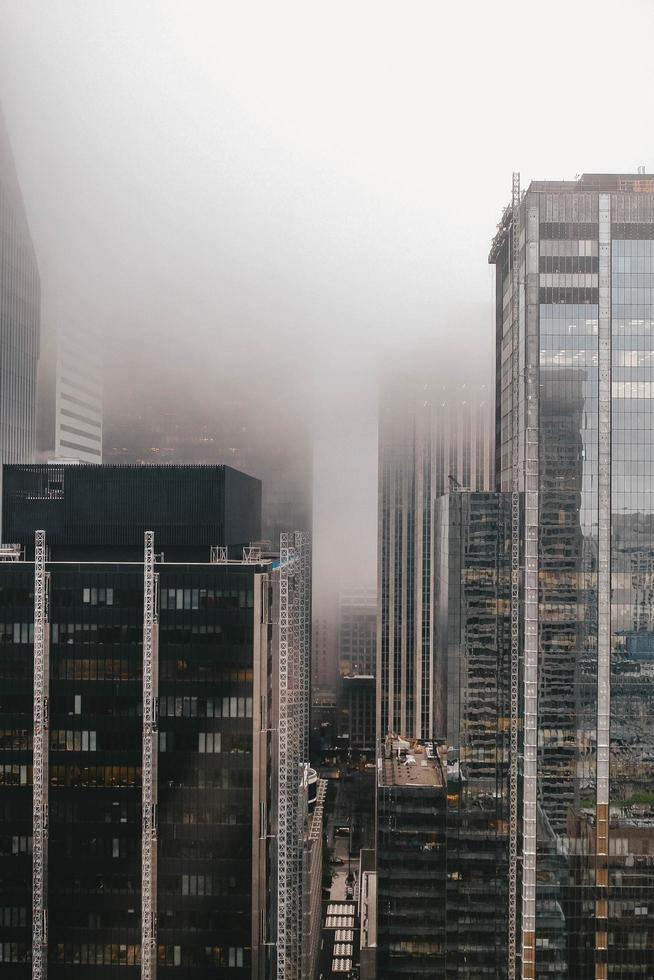 Buildings covered in fog photo