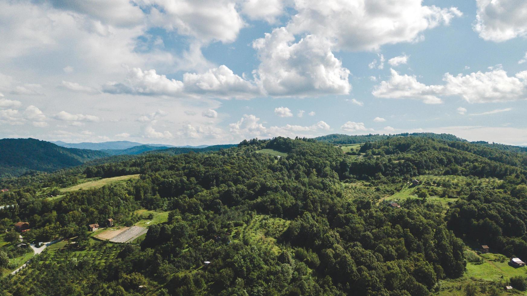 Aerial of farmland and cloudy blue sky photo