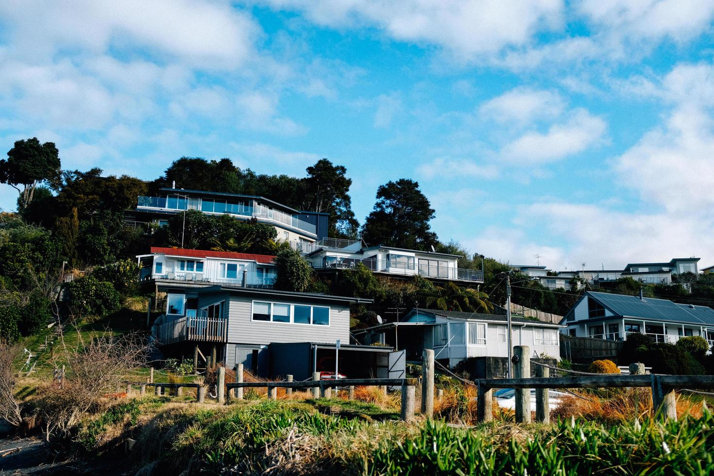 Houses on a hill under cloudy blue sky photo
