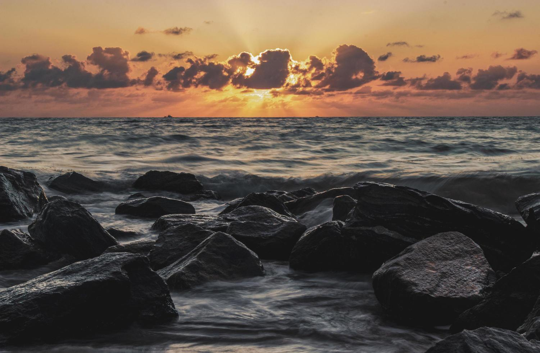 Rocky beach at sunset photo