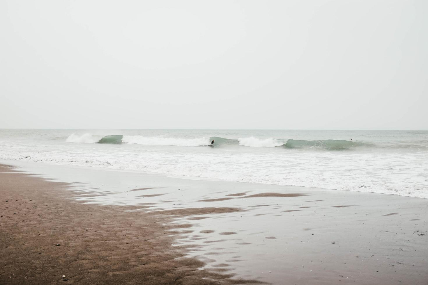 Person surfing on waves photo