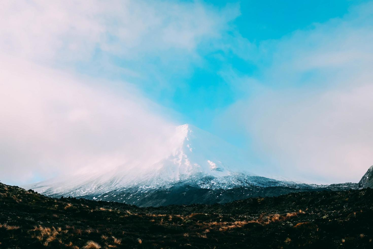 Mountain with cloudy blue sky photo