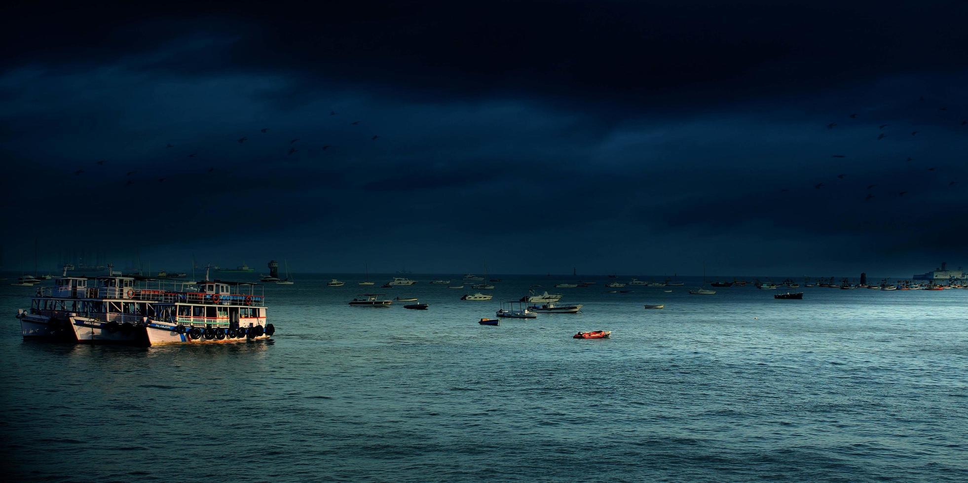 Boats on sea at night photo