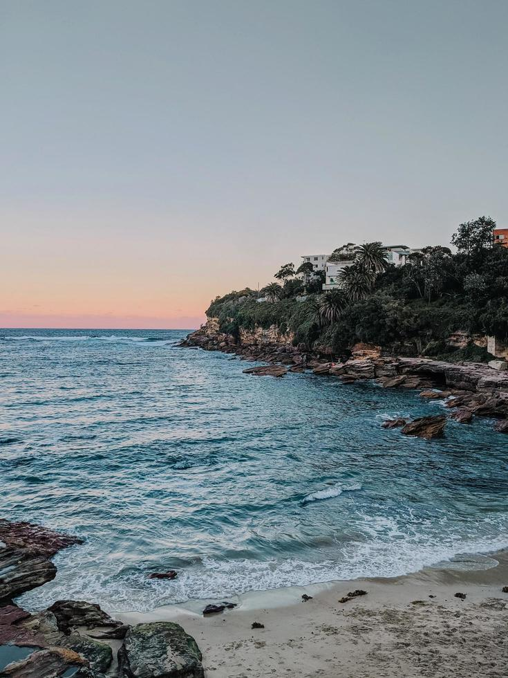 Calm waves on rocky shore photo