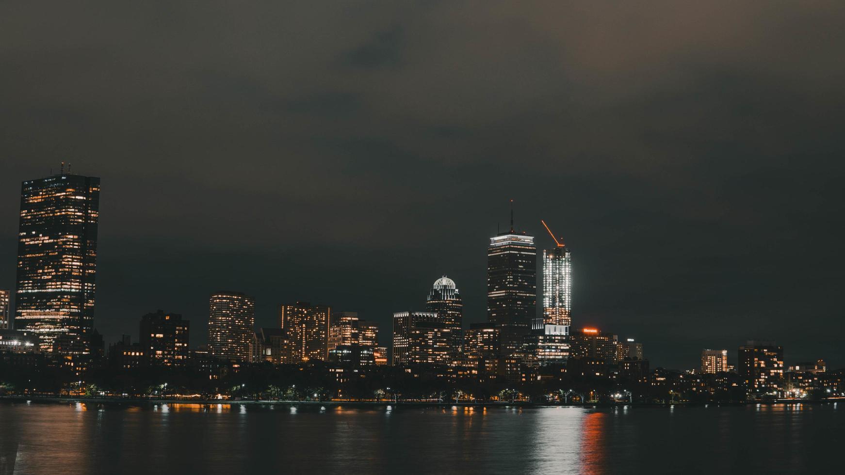 High rise buildings beside sea photo