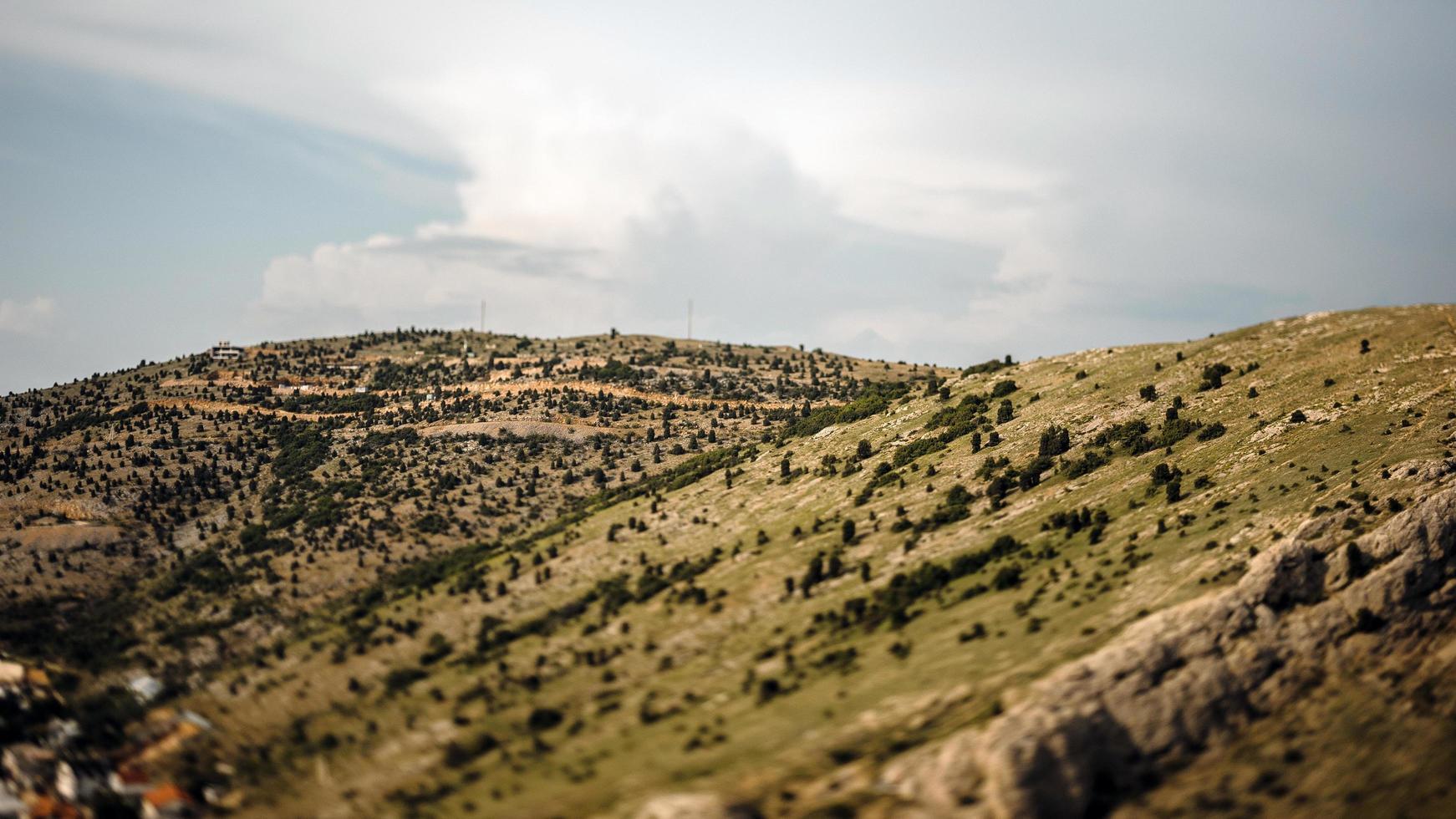 Tilt shift of a green mountain range photo