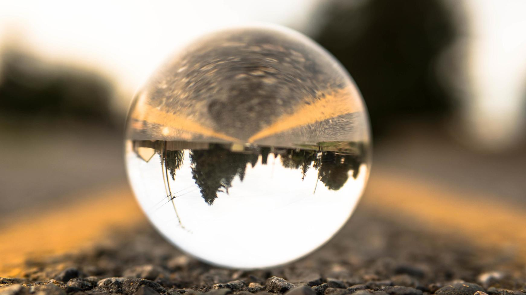 Glass ball on road during daytime photo