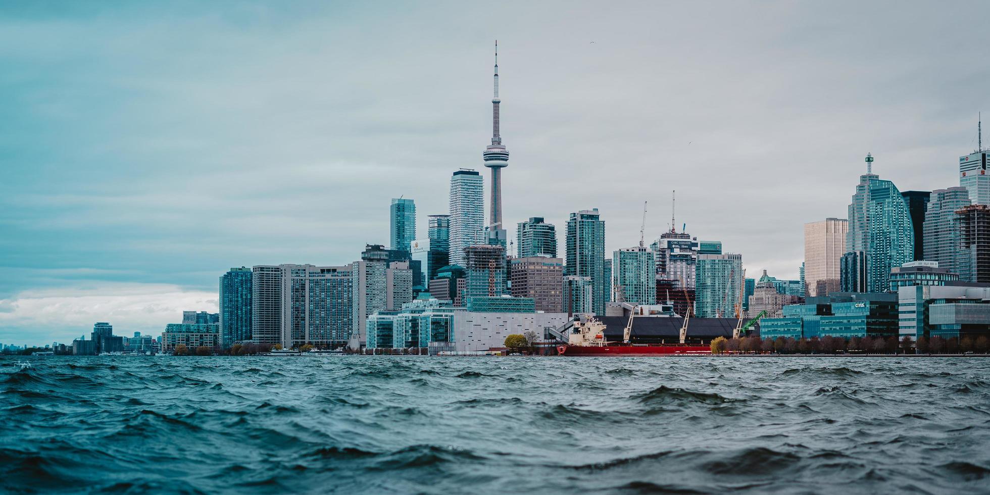 City buildings beside sea photo