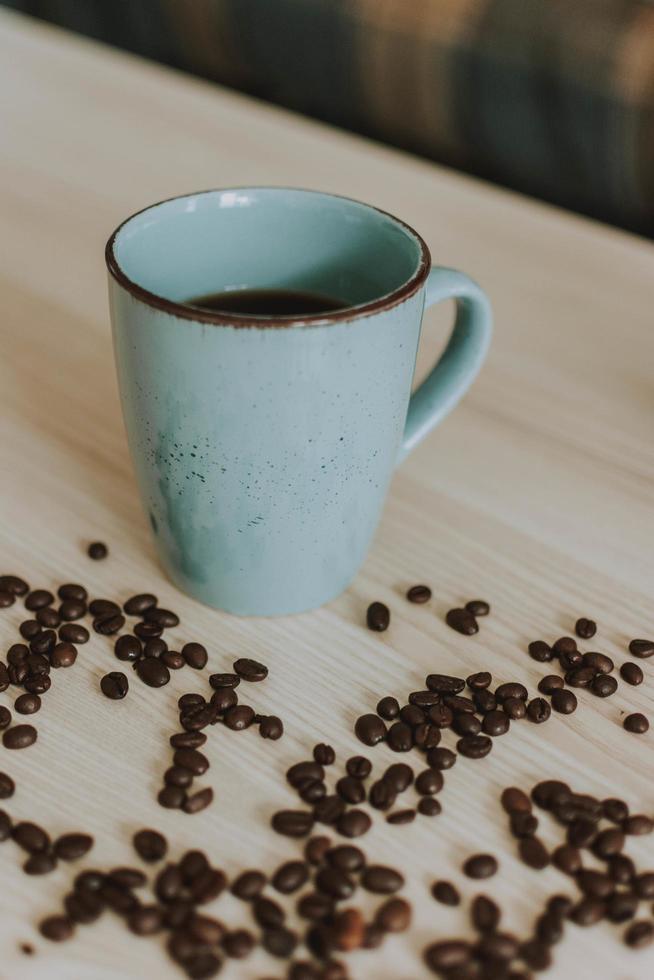 Blue coffee mug with coffee beans photo