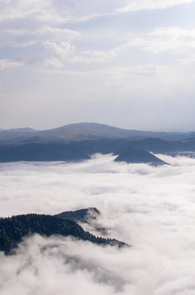 Mountains cover in fog photo