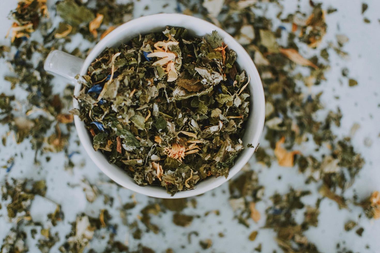 Mug full of dried herbs photo