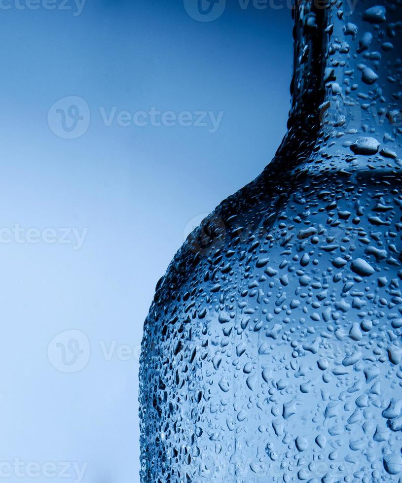 Waterdrops on bottle photo