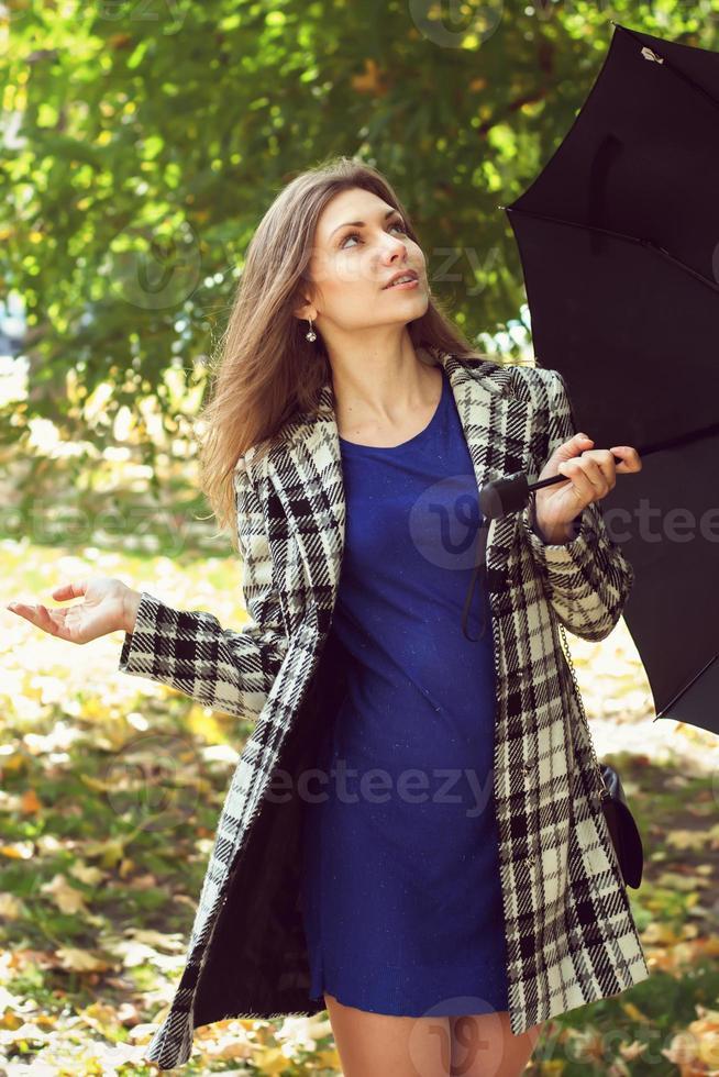 Girl with an umbrella photo