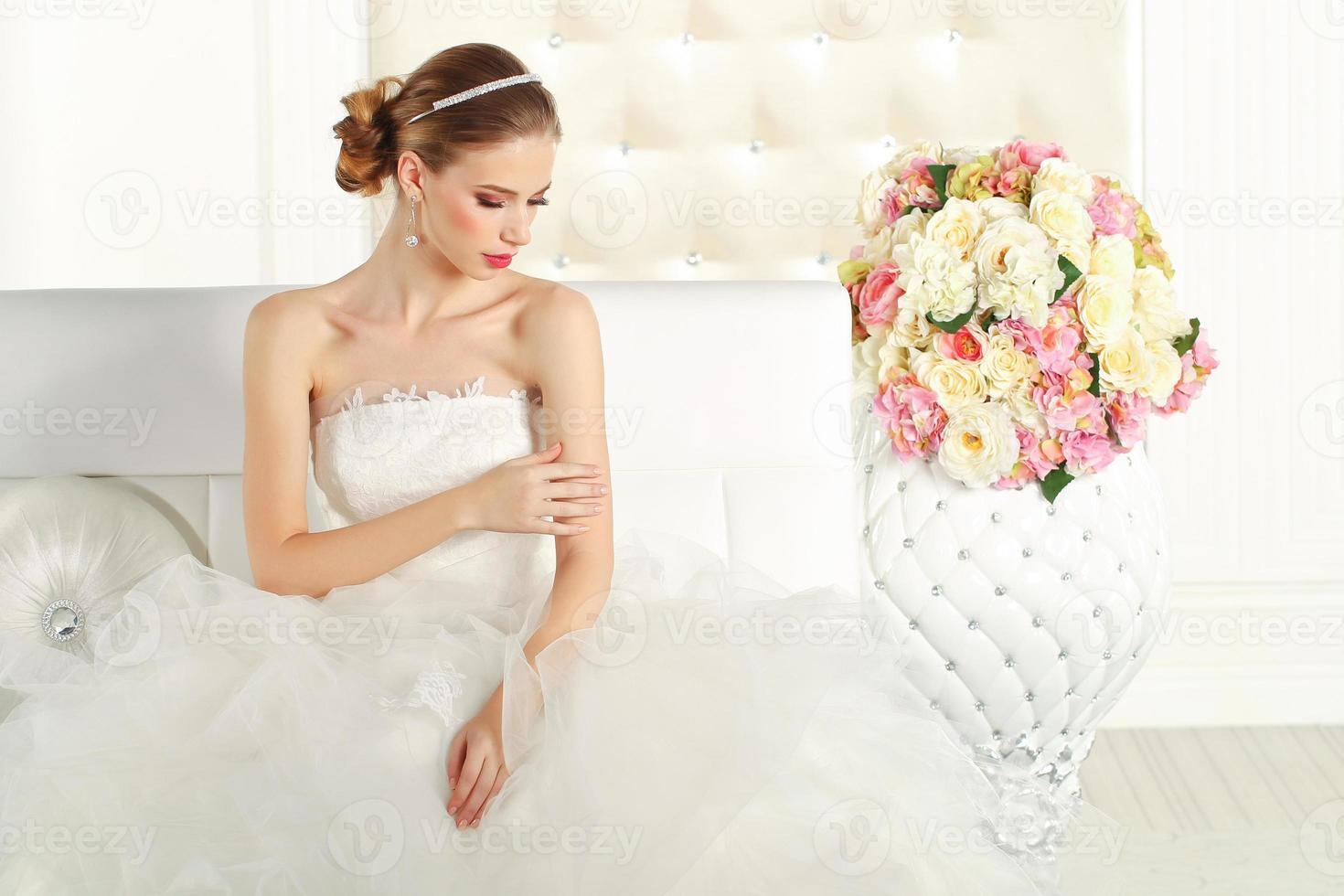 Gorgeous bride on sofa photo