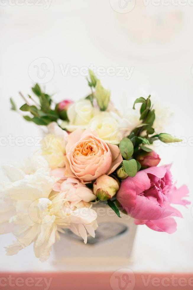 floral arrangement of peonies and roses photo